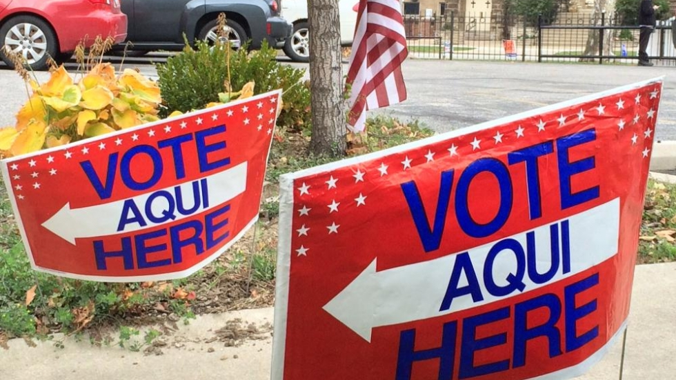 Signs outside a polling place in Cleveland during 2014 elections. Photo by Joanna Richards