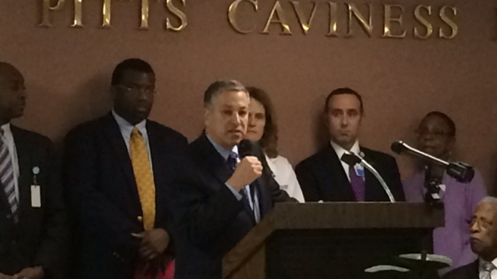 Cuyahoga County Executive Armond Budish rallies a crowd of health care executives, advocates and community leaders.