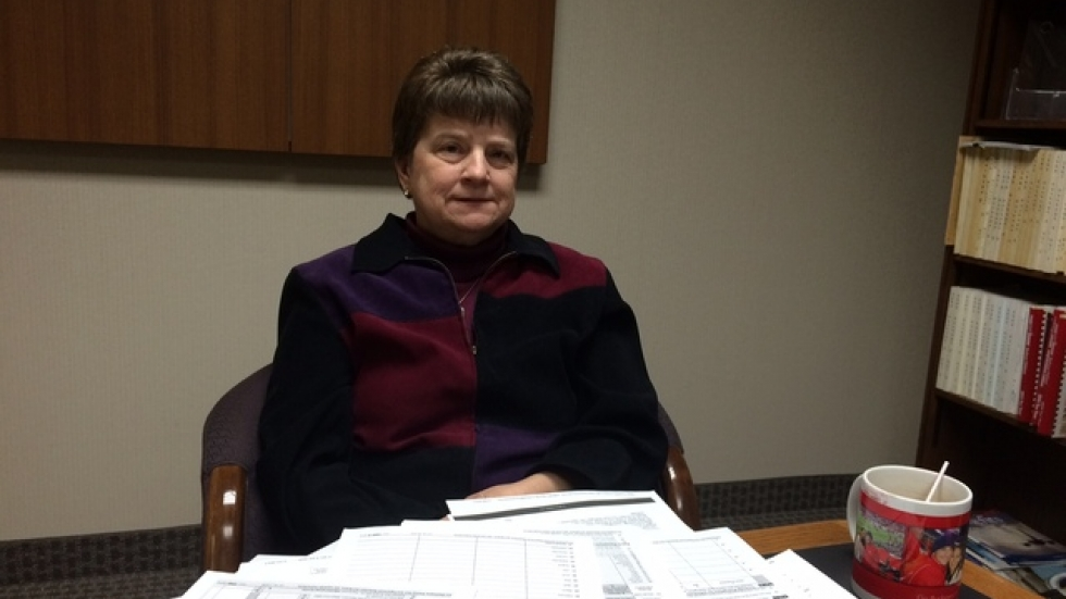 Accountant Cindy Kula displays the piles of tax forms and instructional documents related to new ACA provisions.
