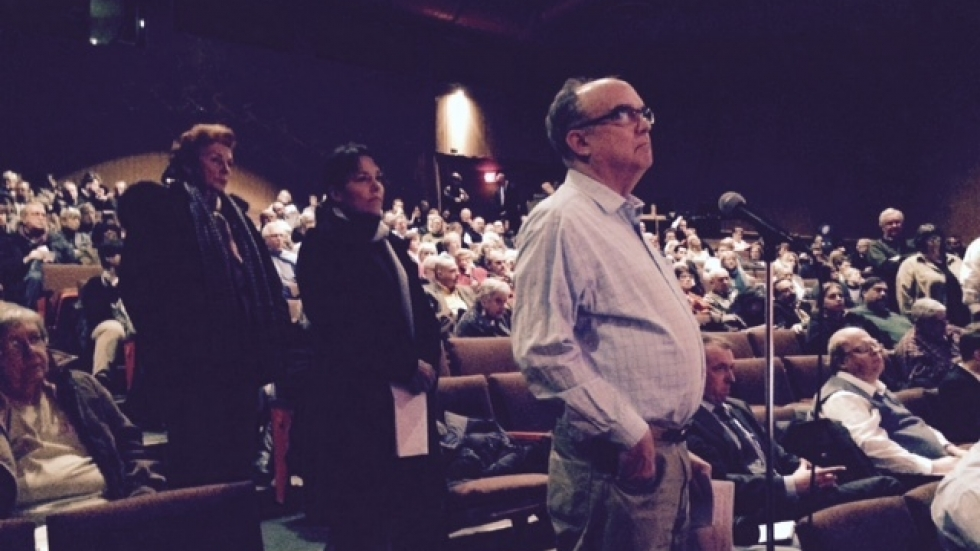 Lakewood residents stand to ask questions during a community forum on the hospital's closure.