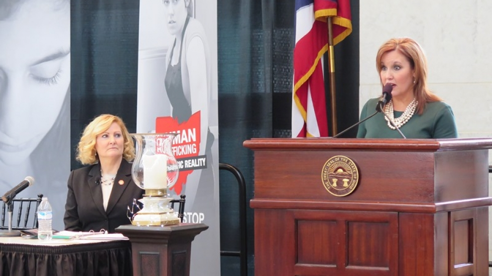 Lt. Gov. Mary Taylor speaks at a human trafficking awareness event, as State Rep. Teresa Fedor looks on.