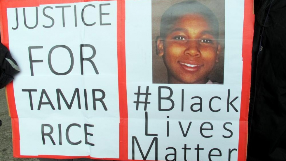 Sign recently carried by demonstrators outside Justice Center (Photo: Brian Bull/ideastream)