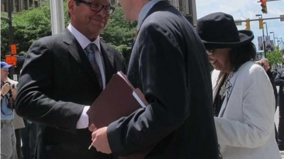 Fred Geis shakes hands with then-Cuyahoga County Executive Ed FitzGerald in 2014.