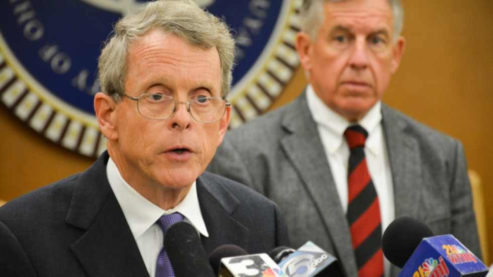 Ohio Attorney General Mike DeWine, flanked by Cuyahoga County Prosecutor Tim McGinty, at a 2014 news conference.
