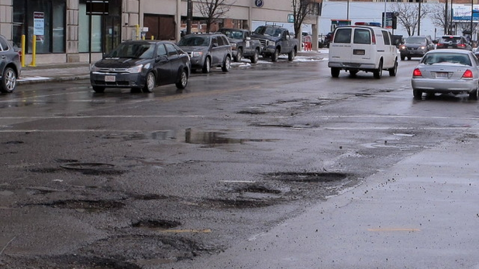 Potholes line a Cleveland street in 2014.