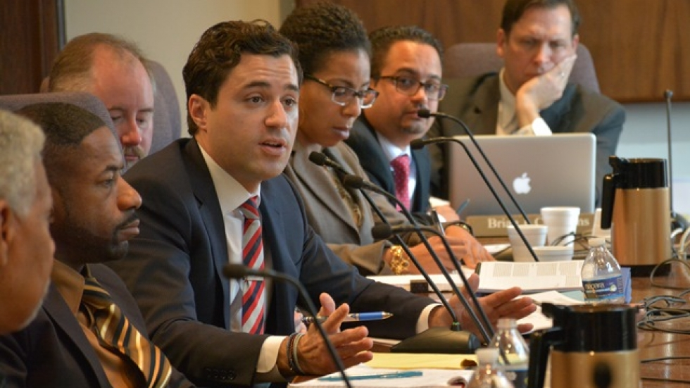 Cleveland's police monitoring team talks with city council earlier this year.