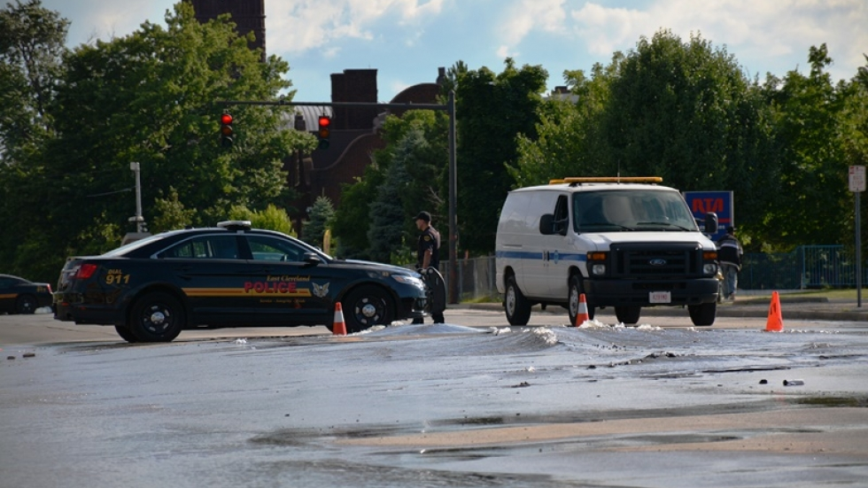 East Cleveland police and Cleveland water department staff respond to a broken water main in 2014.