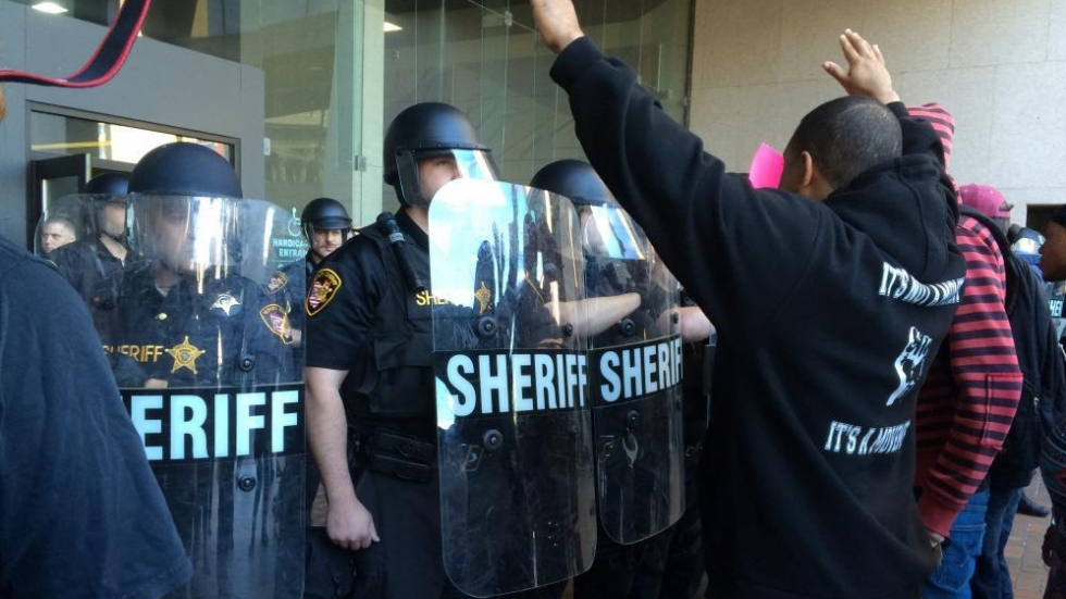 Sheriffs deputies face protesters in Cleveland after the acquittal of Officer Michael Brelo.