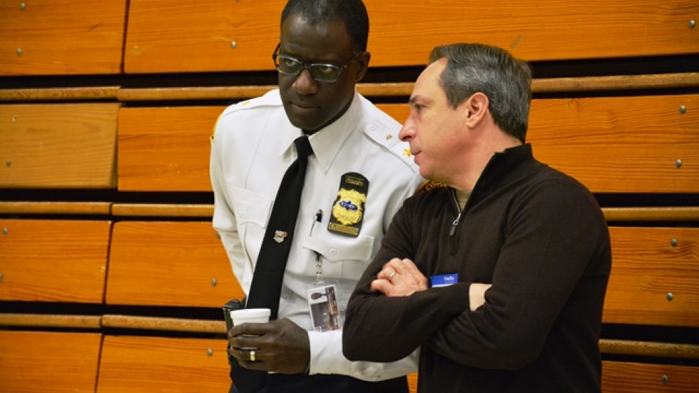Police Chief Calvin Williams speaks with City Council Safety Committee Chair Matt Zone at a 2015 event.
