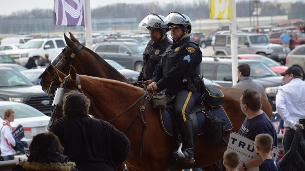Police on horseback observe Trump supporters leaving a rally in Cleveland.