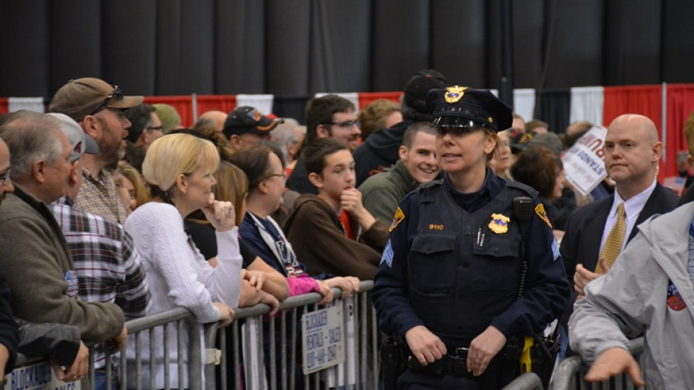 A Cleveland police officer patrols a Donald Trump rally in March.