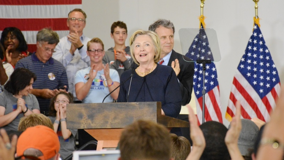 Democratic presidential candidate Hillary Clinton speaks as U.S. Sen. Sherrod Brown looks on.