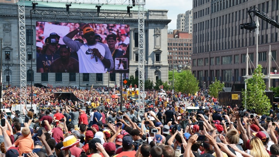 Fans hold up their phones as LeBron James addresses the crowd.