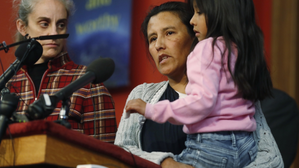 Jeanette Vizguerra, a Mexican woman seeking to avoid deportation from the United States, speaks Wednesday as she holds her 6-year-old daughter, Zuri, during a news conference in a Denver church in which Vizguerra and her children have taken refuge.