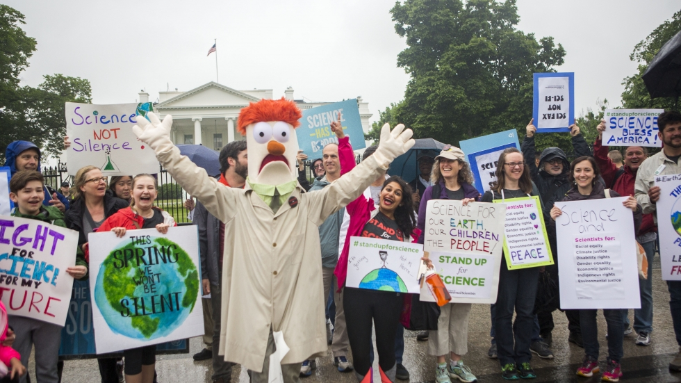 Members of the Union for Concerned Scientists pose for photos with Muppet character Beaker in front of The White House before heading to the National Mall for the March for Science.