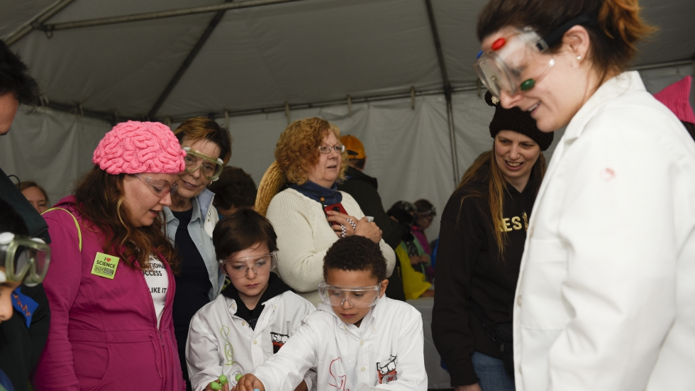 """Abralyn Weidow (left), Geyo and Stirling explore """"Magic Nuudles"""" at the Kids Zone during the March for Science event in Washington, D.C."""
