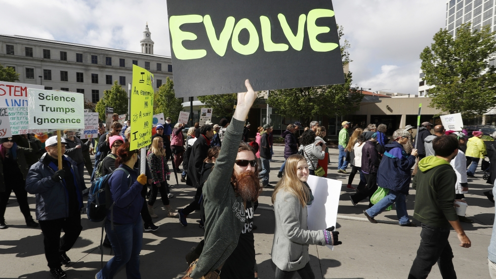Protesters wave signs during the March for Science in Denver, Colo. The organizers don't expect the event to end on Saturday. They've planned a week of action for April 23 through 29.