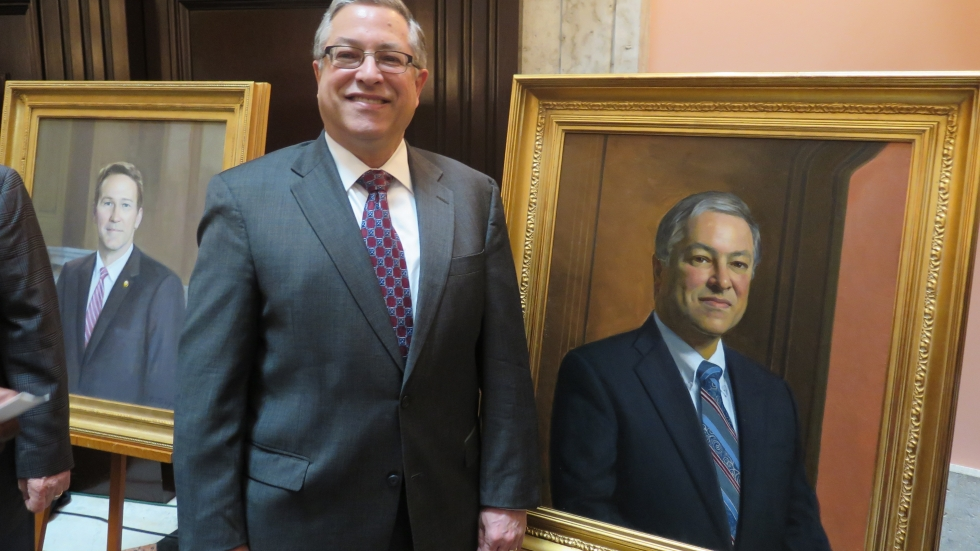 Former Speaker Armond Budish (D-Beachwood, 2009-2011) stands with his portrait by Daniel E. Greene.