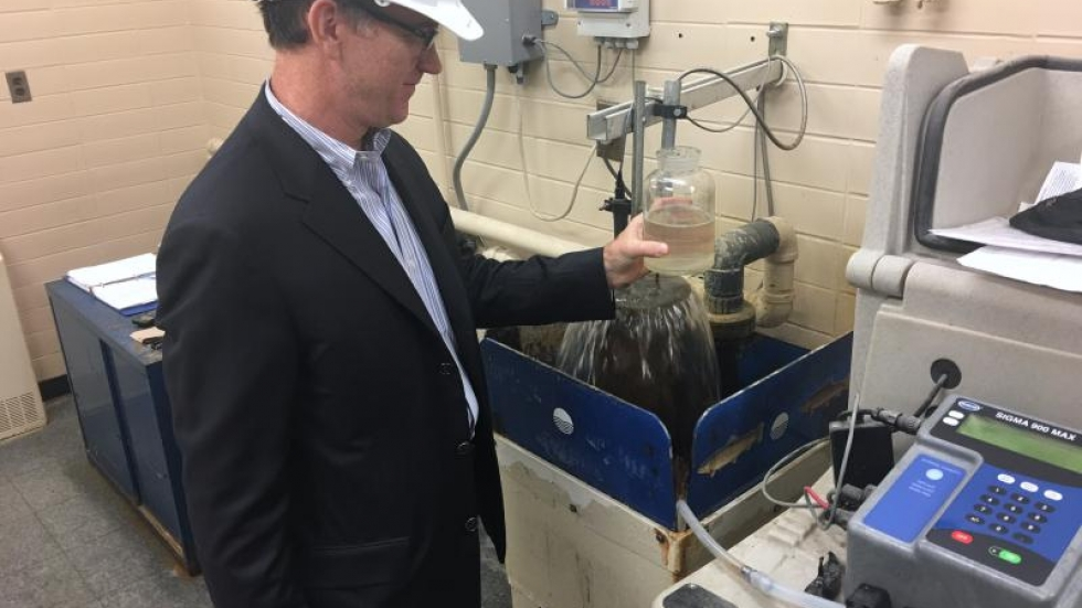Mike Garland shows how water is tested in the wastewater treatment plant before being released back into Lake Ontario.