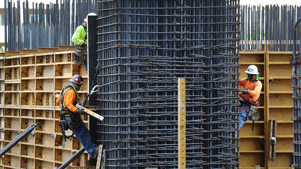 Construction workers at a site in Miami. Thousands of construction workers in the U.S. face the elimination of their Temporary Protected Status and the prospect of deportation.