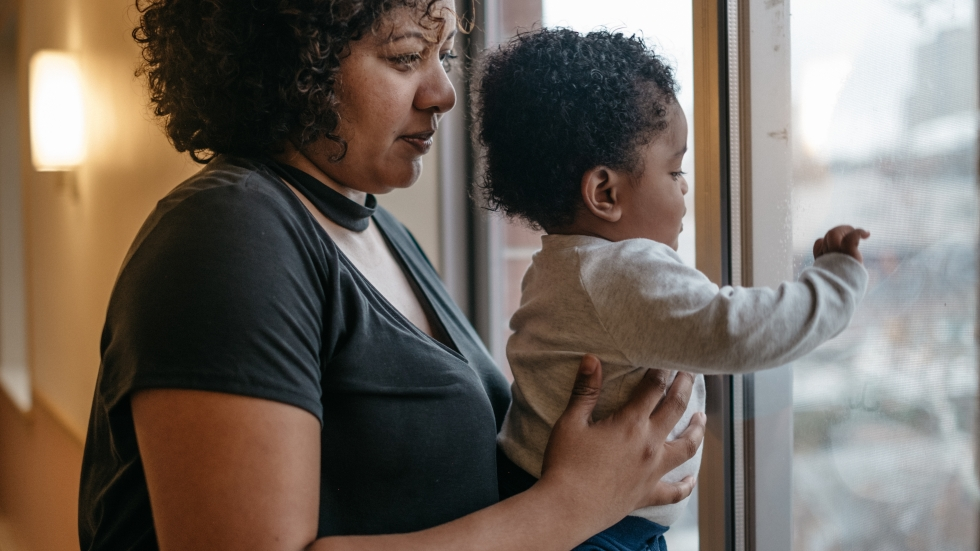 Bianca and her 1-year-old son, Everton, in her Bronx, N.Y., apartment. Bianca had her own pregnancy emergency; Everton was born at just 24 weeks.