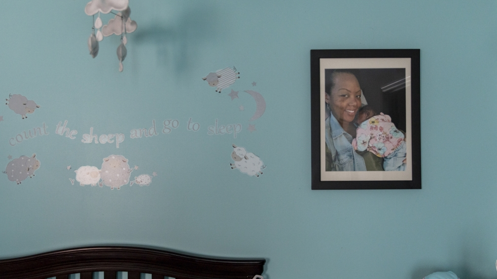A large, framed photograph of newborn Soleil and mother Shalon hangs in Soleil's nursery. Shalon painted the nursery light blue shortly before Soleil was born.