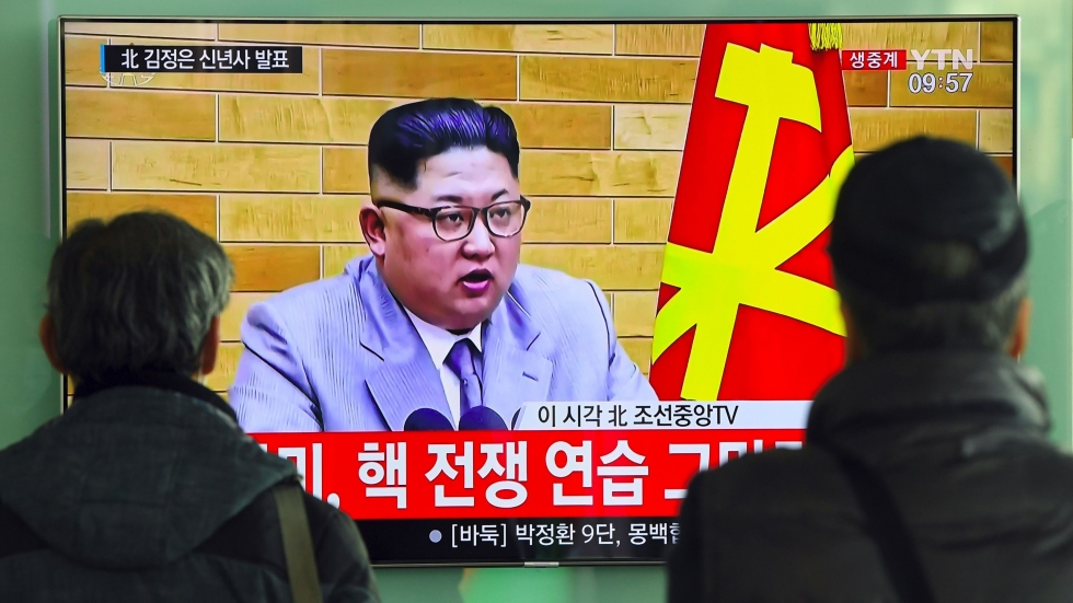 People watch a broadcast showing North Korean leader Kim Jong Un's New Year's speech at a railway station in Seoul, South Korea, on Monday.