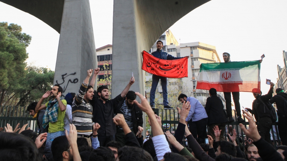 People gather to protest over the high cost of living in Tehran, Iran, on Thursday.