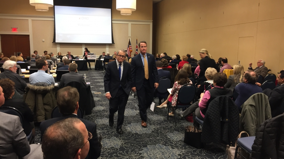 Mike DeWine and Jon Husted at the Ohio Republican Party State Central Committee meeting after delivering a speech to seek the party's endorsement.