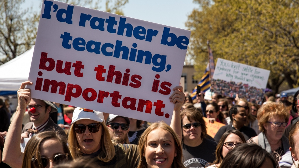 Thousands of teachers and their supporters marched outside the Oklahoma state Capitol building during the third day of a statewide education walkout on April 4. The strike ended this week.