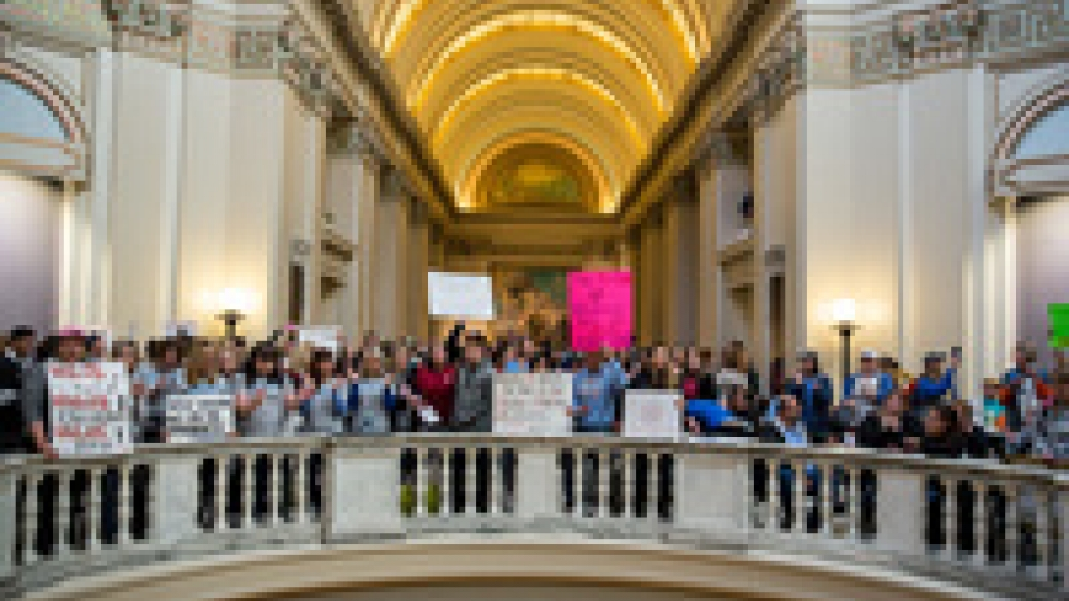 Thousands rally inside the Oklahoma state Capitol building on April 4.
