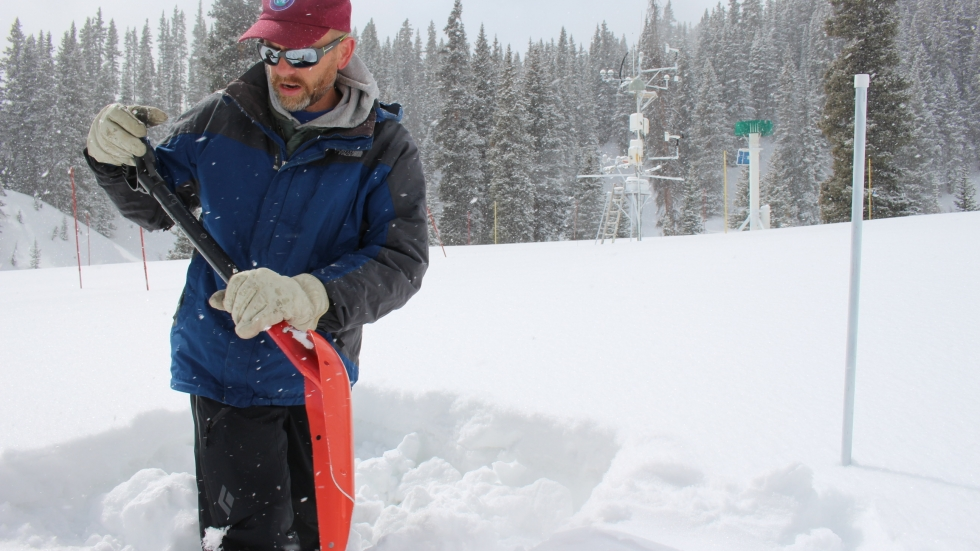 Jeff Derry, director of the Colorado-based Center for Snow and Avalanche Studies, digs a snow pit at the Swamp Angel monitoring site in the San Juan Mountains.