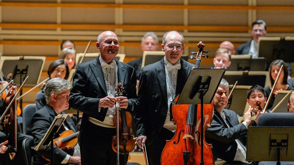 Violinist William Preucil (left), taking a bow with the Cleveland Orchestra at a 2016 performance in Miami.