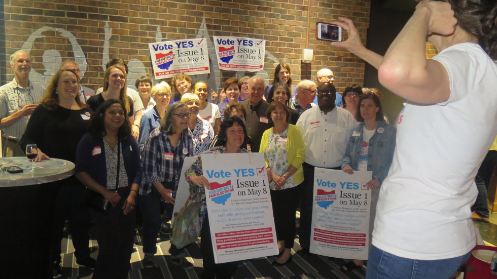 Citizen supporters of redistricting reform who had worked with lawmakers to get the plan before voters celebrated their win in May 2018.