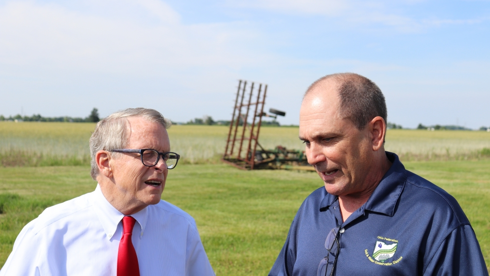 Gov. Mike DeWine talks to farmer Kris Swartz in Perrysburg on June 19, 2019.