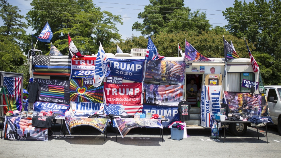 A merchandise truck sits in the parking lot of the Williams Arena before a rally with President Trump in Greenville, N.C., on Wednesday.