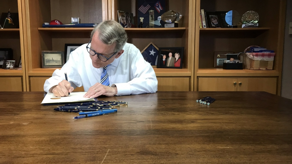 Gov. Mike DeWine signs his first budget.