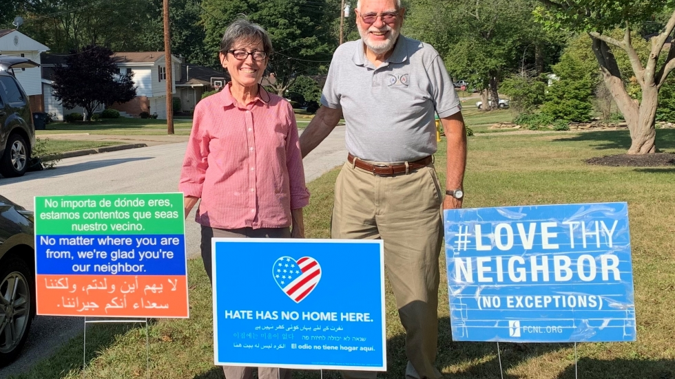 John and Linda Beaty stand in their front yard.