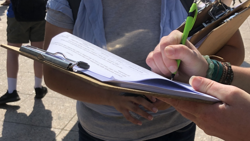 HB6 Referendum petitioners collect signatures outside of the Ohio Statehouse.