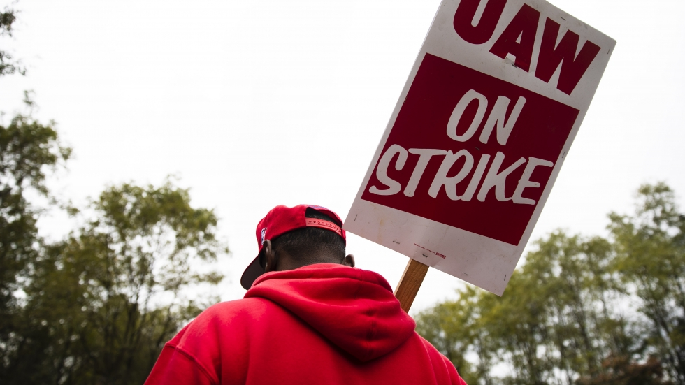 A member of the United Auto Workers pickets earlier this month outside a General Motors facility in Langhorne, Pa. On Friday the union's members voted to ratify a tentative deal with the automaker, bringing an end to a national strike that lasted 40 days.