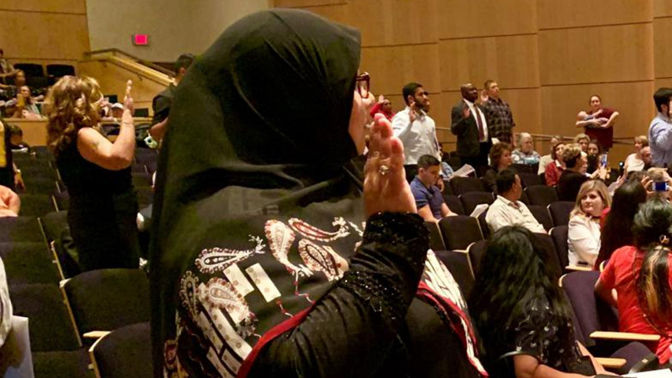 A group of 52 immigrants were sworn-in as U.S. citizens at this year's Constitution Day celebration at the Akron-Summit County Public Library. [M.L. Schultze / WKSU]