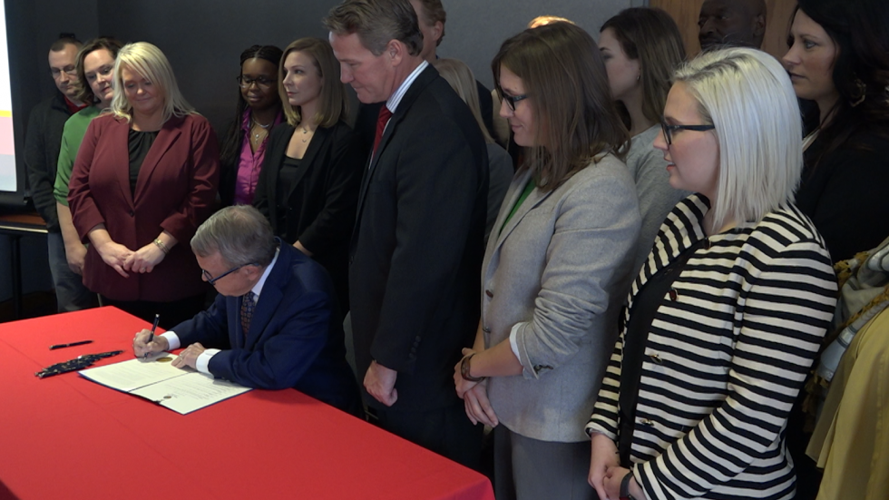 Gov. DeWine signs executive order on foster care