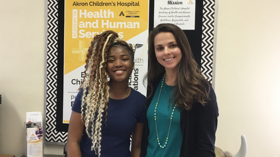 North High School student Destiny Perryman (left) is pictured with the school's College and Career Academies Coach Janice Weaver. Through her Academy program at Akron Children's Hospital Perryman earned certification as a phlebotomist.