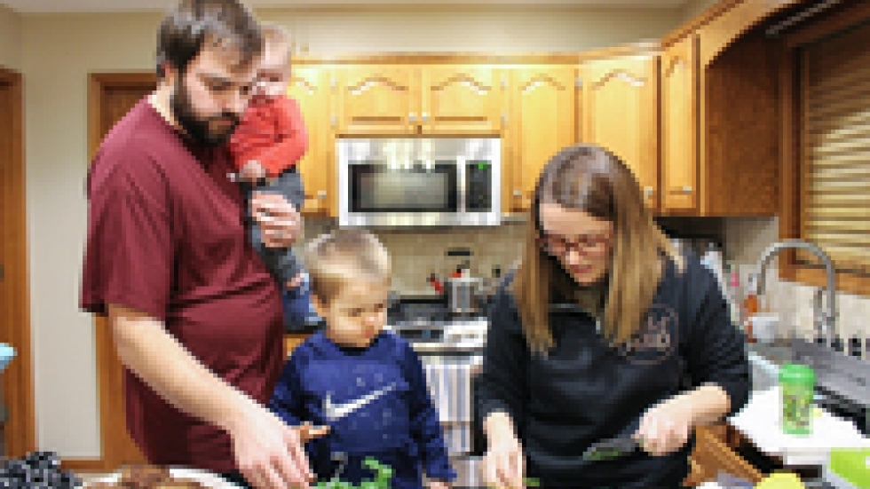 Dietitian Sherise Beckham cooks dinner with her family — husband Tanner, 8-month-old Barrett and 2-year-old Warren. Non-routine childbirths are trickier than they were before the hospital closure, as the family learned firsthand: Beckham needed a cesarean section, and her baby was sent to a hospital an hour away for intensive care.