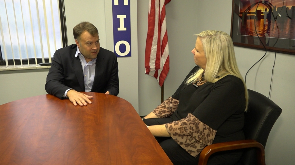 Ohio Democratic Party Chair David Pepper speaks to Jo Ingles