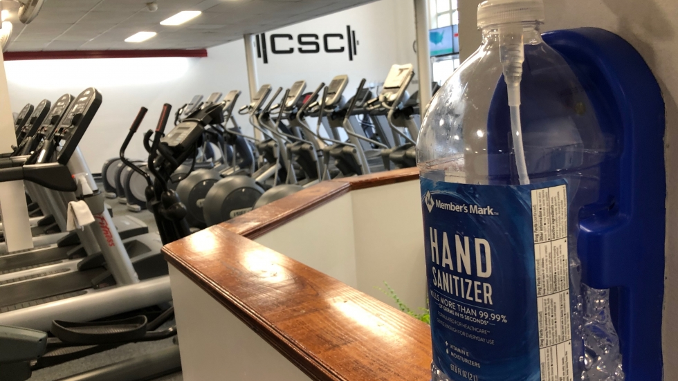Hand Sanitizers, wipes, disinfectant spray bottles can be found all around the gym at the Columbus Sports Connection. Trainer Todd Zody says they take cleanliness seriously.