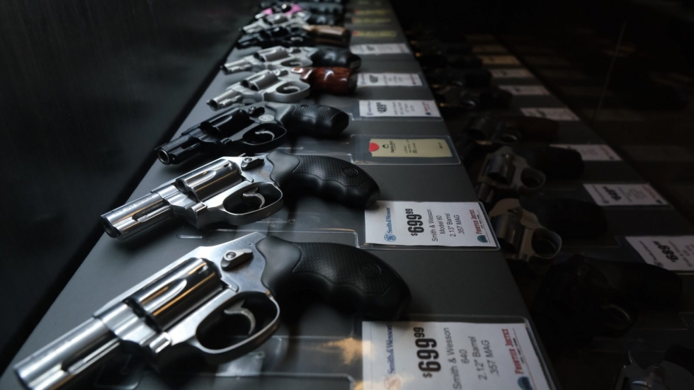 Pistols for sale at a Lee's Summit, Mo., store pictured in this 2018 file photo. Some governors have issued orders closing gun stores as part of efforts to stop the spread of the coronavirus.