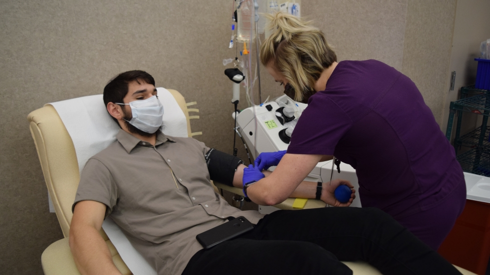 Menachem Mendel Mangel, recovered from COVID-19, donates blood plasma to Community Blood Center in Dayton to help others.
