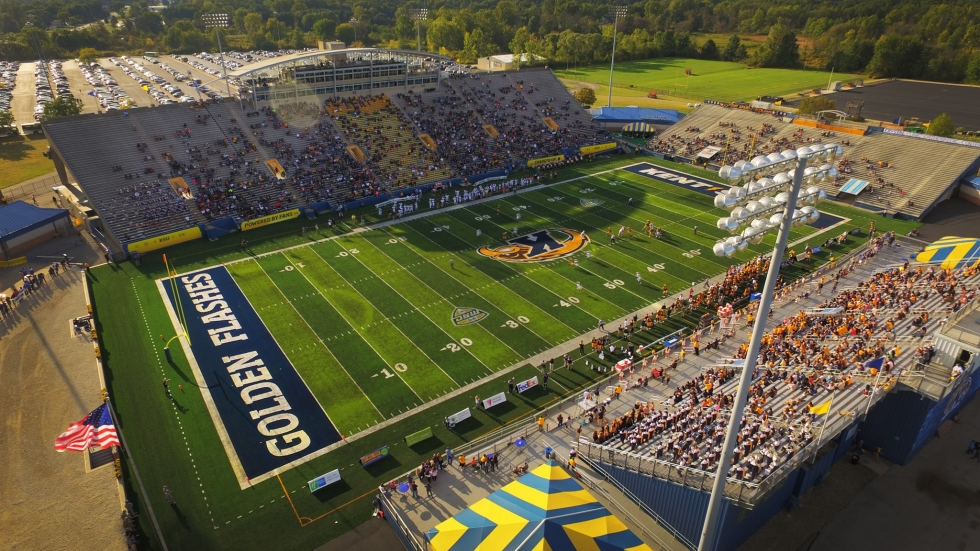 Terry Pluto says schools like Kent State and Akron need to consider dropping Division I football as part of budget cuts.