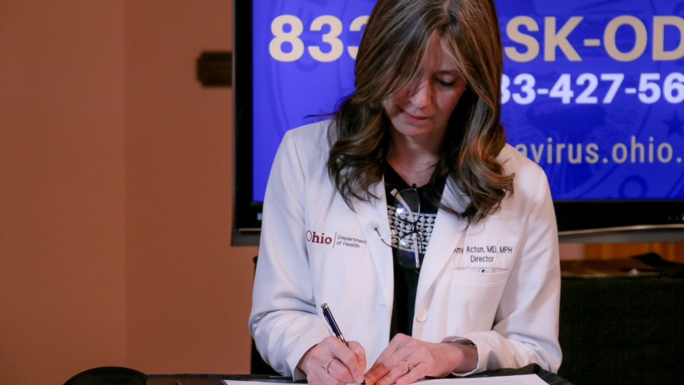 Ohio Department of Health Director Dr. Amy Acton signs an extension of the state's Stay At Home Order on April 2, 2020.